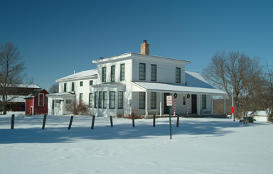 Snow covered two story Hooper Bowler House